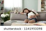 sleepy pregnant woman taking... | Shutterstock . vector #1141953398