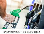 man is holding a gasoline fuel... | Shutterstock . vector #1141971815