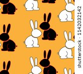 Stock vector seamless pattern of funny rabbit hare vector illustration of a cartoon cheerful hare seamless 1142032142