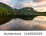 French landscape - Jura. View over the lake of Bonlieu in the Jura mountains (France) at sunset.
