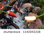 toasting bread and sausage over ... | Shutterstock . vector #1142042228