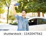 attractive young hispanic man...   Shutterstock . vector #1142047562