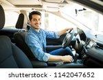 portrait of handsome young man...   Shutterstock . vector #1142047652