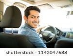 portrait of good looking young... | Shutterstock . vector #1142047688