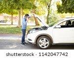 portrait of young man standing... | Shutterstock . vector #1142047742