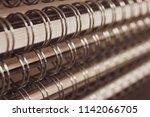 Stack of ring bound sketchbooks