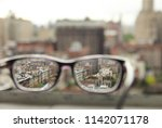 view of nyc through glasses  | Shutterstock . vector #1142071178