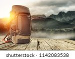 backpack on wooden desk with... | Shutterstock . vector #1142083538