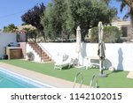 pool stage at country house in... | Shutterstock . vector #1142102015