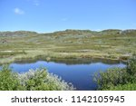 beautiful norwegian lake | Shutterstock . vector #1142105945