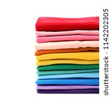 stack of colorful t shirts on... | Shutterstock . vector #1142202305