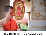 thai monk is praying and... | Shutterstock . vector #1142219918