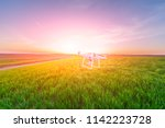 drone quad copter on yellow... | Shutterstock . vector #1142223728