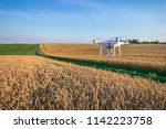 drone quad copter on yellow... | Shutterstock . vector #1142223758