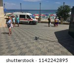 an ambulance on the seafront of ... | Shutterstock . vector #1142242895