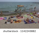 people are resting on the... | Shutterstock . vector #1142243882