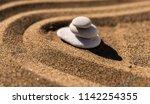 zen meditation stone in sand ... | Shutterstock . vector #1142254355
