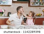 little kid girl play with man... | Shutterstock . vector #1142289398