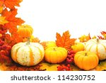 Border or frame of pumpkins and vibrant autumn leaves over white - stock photo