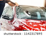 car washing concept. man... | Shutterstock . vector #1142317895