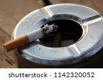 closeup of smoked cigarette in... | Shutterstock . vector #1142320052