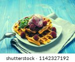 plate of belgian waffles with... | Shutterstock . vector #1142327192