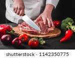 chef butcher cutting pork meat... | Shutterstock . vector #1142350775