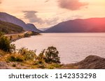 beautiful fjord in evening... | Shutterstock . vector #1142353298
