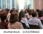 rear view of audience in the... | Shutterstock . vector #1142358662