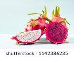 half and slice dragon fruit on... | Shutterstock . vector #1142386235