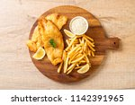 fish and chips with french... | Shutterstock . vector #1142391965