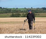 Metal Detecting In A Field Of...