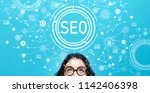 seo with young woman on a blue...   Shutterstock . vector #1142406398
