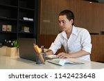 businessman using credit card... | Shutterstock . vector #1142423648