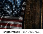 usa flag on a wood surface | Shutterstock . vector #1142438768