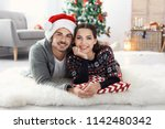 happy young couple celebrating... | Shutterstock . vector #1142480342