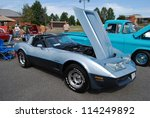 FREDERICK, MD -SEPTEMBER 16: A 1979 Blue Chevrolet Corvette with an open hood at a Car Show on September 16, 2012 in Frederick, MD USA. A Alzheimer's Benefit Car Show in Maryland. - stock photo