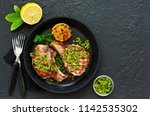 pork cutlet on a bone with... | Shutterstock . vector #1142535302