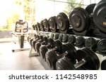 dum bell row in gym for people...   Shutterstock . vector #1142548985