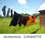 clothes hanging on washing line ...   Shutterstock . vector #1142604755