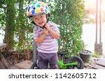 cute little asian 2 years old... | Shutterstock . vector #1142605712