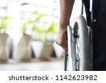 closeup disabled man hand on... | Shutterstock . vector #1142623982