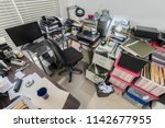 cluttered messy business office ...   Shutterstock . vector #1142677955