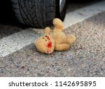Toy Bear Under The Car Wheels