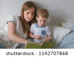 family mom and son toddler read ... | Shutterstock . vector #1142707868
