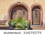 entrance doors. the ancient...   Shutterstock . vector #1142752775