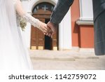 bride and groom holding hands... | Shutterstock . vector #1142759072