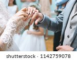 bride putting on wedding ring... | Shutterstock . vector #1142759078
