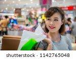 asian woman enjoying in... | Shutterstock . vector #1142765048