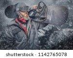 portrait of a snowboarder... | Shutterstock . vector #1142765078